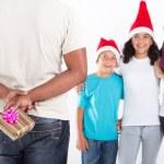 Hiding Christmas gift — Stock Photo
