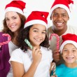 Family with Christmas candy cane — Foto de Stock