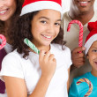 Family with Christmas candy cane — Stockfoto