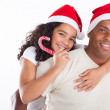 Happy father carrying daughter with Christmas hat — Stock Photo