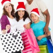 Foto Stock: Happy family christmas shopping