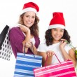 Happy mother and daughter with Christmas shopping bags — Stockfoto