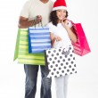 Happy father and daughter carring christmas shopping bags — Stock Photo #11308075
