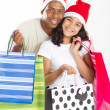 Father and daughter with Christmas shopping bags — Stock Photo #11308076