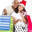 Father and daughter with Christmas shopping bags - Stock Photo