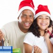 Happy father and daughter with Christmas shopping bags — Stockfoto