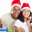 Happy father and daughter with Christmas shopping bags — Stock Photo