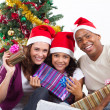 Happy multiracial family with gifts at Christmas — Φωτογραφία Αρχείου