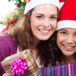 Happy mother and daughter holding Christmas gifts — Stock Photo #11308093
