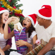 Happy family opening Christmas gift at home — Stock Photo #11308095