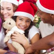 Happy multiracial family with gifts at Christmas — 图库照片