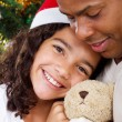 Stock Photo: Happy daughter hugging daddy with Christmas gift