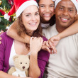 Happy multiracial family with gifts at Christmas — Stock Photo #11308105