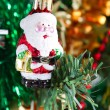 Little santa claus ornament hanging on christmas tree — Zdjęcie stockowe