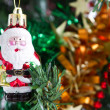 Royalty-Free Stock Photo: Little santa claus ornament hanging on christmas tree