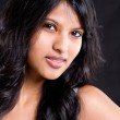 Young indian woman portrait on black — Stock Photo #11308587
