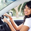 Young indian woman driving a car — Stock fotografie