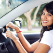 Stock Photo: Young indian woman driving a car