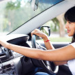Female driver using GPS navigator - Foto Stock
