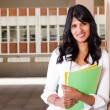 Female university student inside campus building — Stock Photo