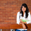 Female university student inside campus building — Stock Photo #11308655