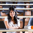 Female college student in university lecture room — Stock Photo