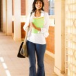 Cute female college student in school building — Stock Photo #11308674