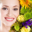 Attractive young woman portrait with flowers — Stock Photo
