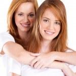 Teen sisters portrait on white — Stock Photo