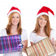 Young women holding christmas presents — Stock Photo