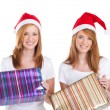 Young women holding christmas presents — Stockfoto