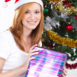 Happy young woman holiday Christmas present — Stock Photo