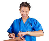African doctor checking patient's pulse — Stock Photo