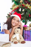 Cute little girl with christmas presents — Stock Photo