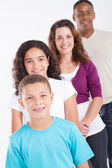 Happy multiracial family of four studio portrait — Stock Photo