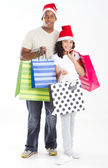 Happy father and daughter carring christmas shopping bags — Stock Photo
