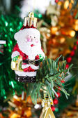 Little santa claus ornament hanging on christmas tree — Stock Photo