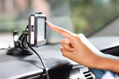 Finger pointing at car GPS navigation system — Stock Photo