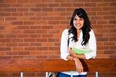 Female university student inside campus building — Stock Photo