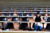 Female college student in university lecture hall — Stock Photo