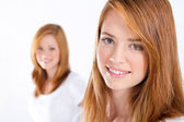 Beautiful teen girls on white — Stock Photo
