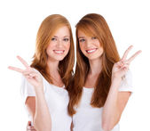 Young teen girl giving victory hand sign — Stock Photo
