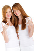 Happy teen twin sisters on white — Stock Photo