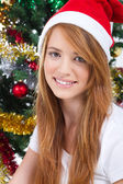 Beautiful teen girl in front of a Christmas tree — Stok fotoğraf