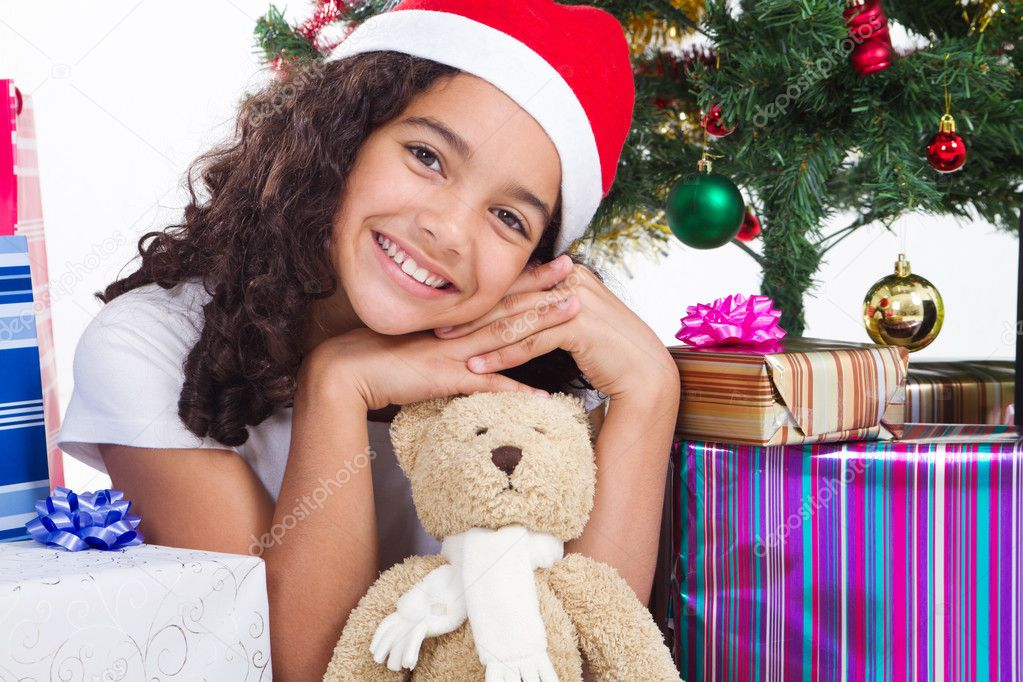 Happy cute little girl with presents near a christmas tree — Stock Photo #11307960