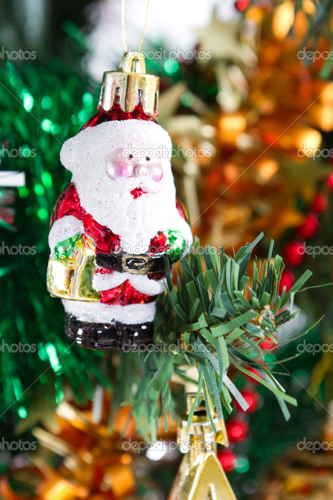 Little santa claus ornament hanging on christmas tree — Zdjęcie stockowe #11308119