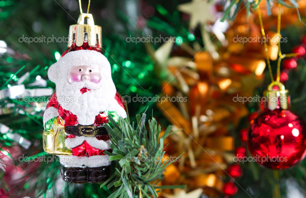 Little santa claus ornament hanging on christmas tree — Stock Photo #11308124