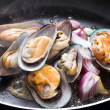 Fry mussel and onion in frying pan — Stock Photo #11338890