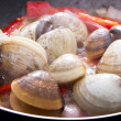 Stock Photo: Clams cooking in pan