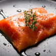 Fresh salmon fillet on a frying pan — ストック写真